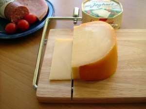 Continenta Käseschneider - Holz Käseschneidbrett